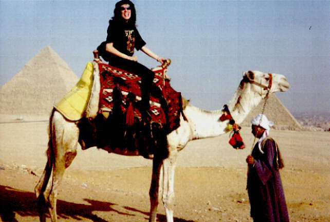 Daleela at the Pyramids, on a camel
